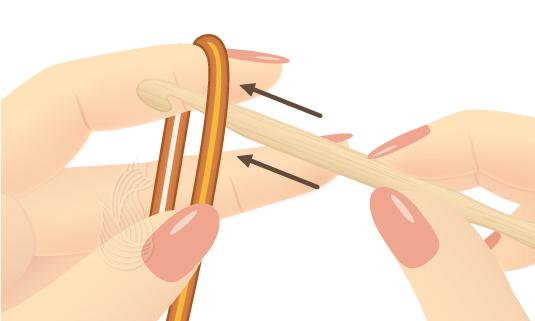 Tying a Crochet Slip Knot Step 1: Hands slipping a crochet hook under a piece of orange yarn