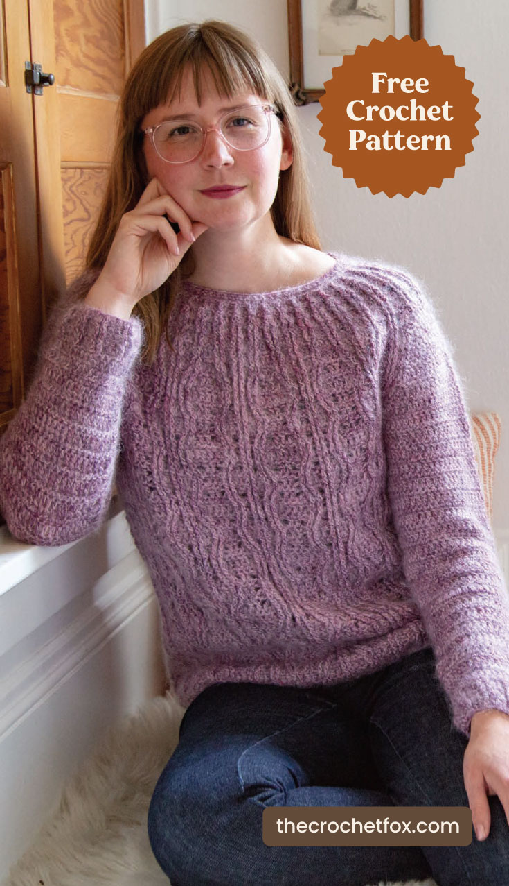 "A woman wearing a purple crochet sweater indoors and text area which says ""Free Crochet Pattern, thecrochetfox.com"""