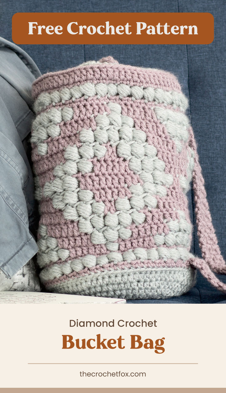 """Text area which says """"Free Crochet Pattern"""" next to a gray and pink crochet bucket backpack on a blue couch followed by another text area which says """"Diamond Crochet Bucket Bag, thecrochetfox.com"""""""