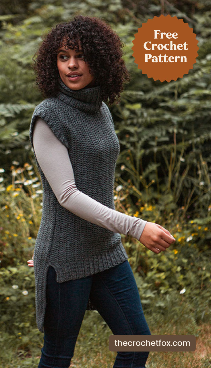"A woman wearing green turtle neck crochet tunic vest outdoors and text area which says ""Free Crochet Pattern, thecrochetfox.com"""