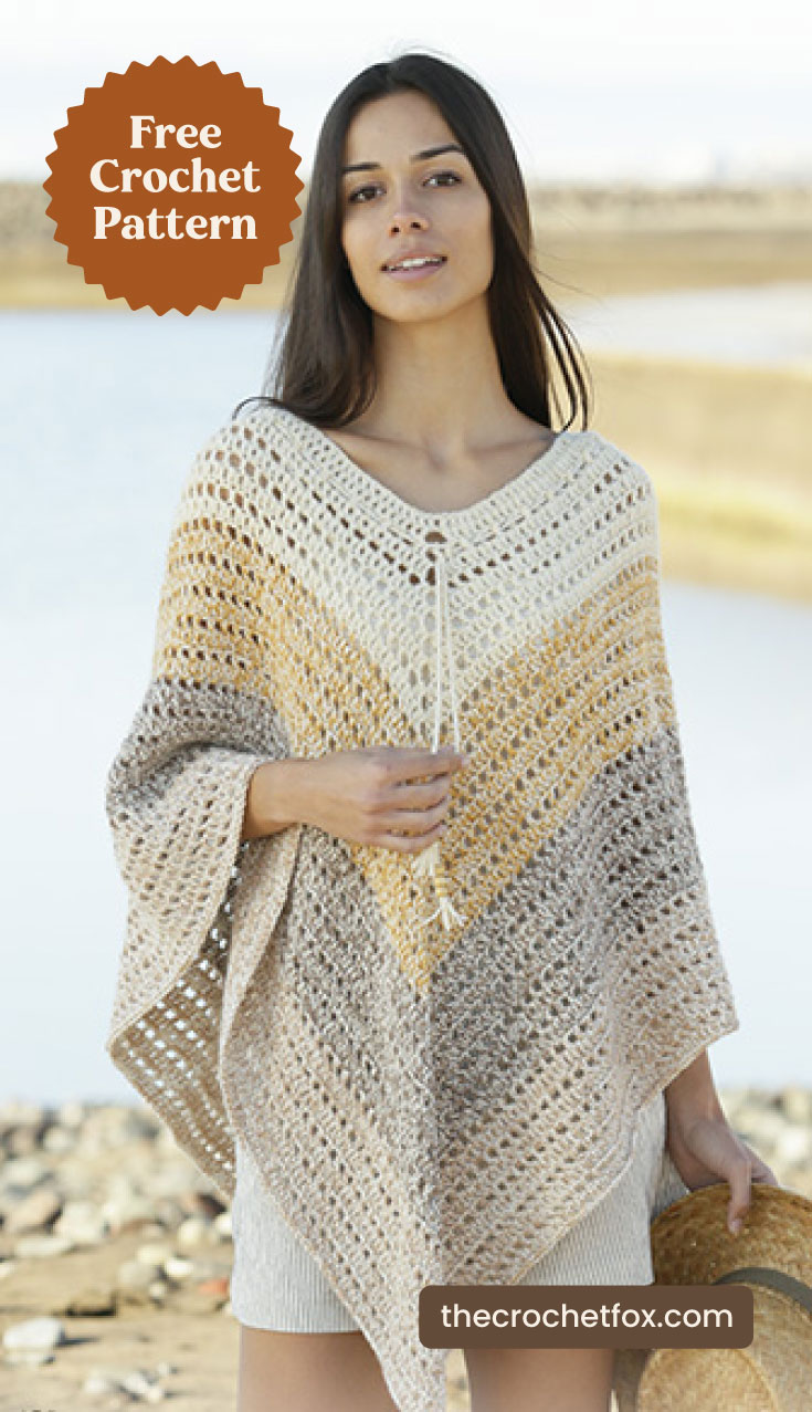 """A woman wearing a striped crocheted poncho at the beach and text area which says """"Free Crochet Pattern, thecrochetfox.com"""""""