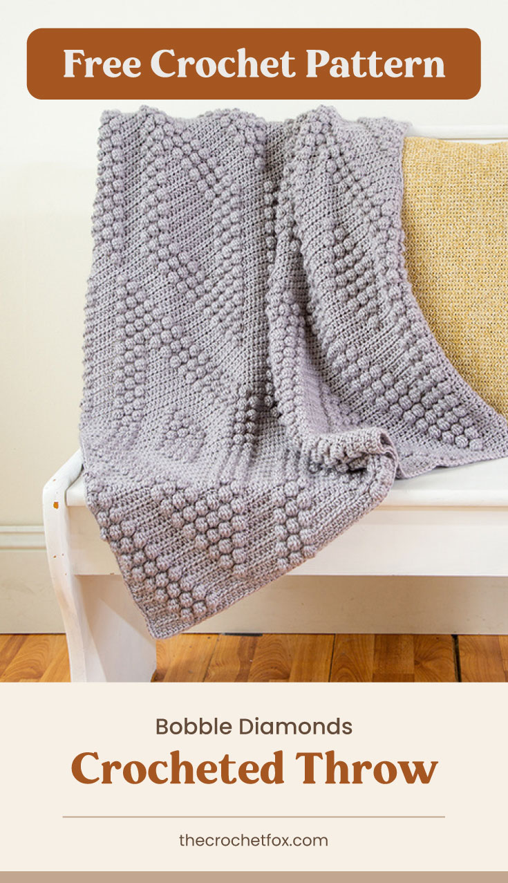 """Text area which says """"Free Crochet Pattern"""" next to a gray crochet throw blanket draped over a white bench followed by another text area which says """"Bobble Diamonds Crocheted Throw, thecrochetfox.com"""""""