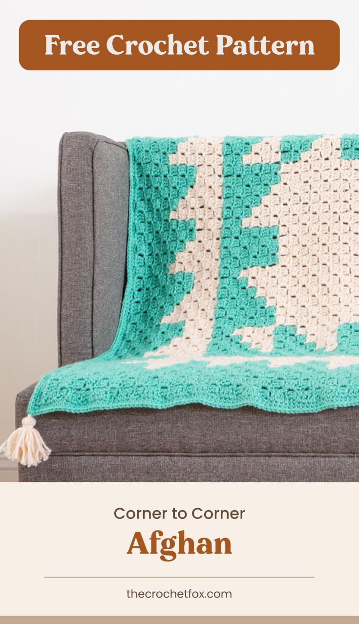 """Text area which says """"Free Crochet Pattern"""" next to a tassled white and mint crocheted afghan draped over a gray couch  followed by another text area which says """"Corner to Corner Afghan, thecrochetfox.com"""""""