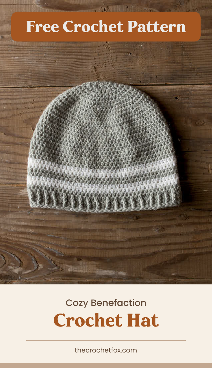 "Text area which says ""Free Crochet Pattern"" next to a gray crochet hat with white stripes laid on a wooden surface followed by another text area which says ""Cozy Benefaction Crochet Hat,thecrochetfox.com"""