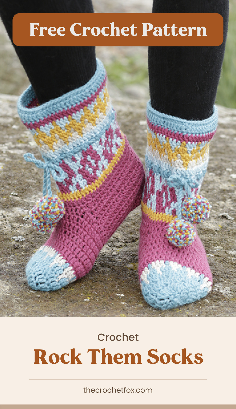 """Text area which says """"Free Crochet Pattern"""" next to close-up of a pair of feet wearing crocheted socks with colorful nordic patterns with pompom accents followed by another text area which says """"Crochet Rock Them Socks, thecrochetfox.com"""""""