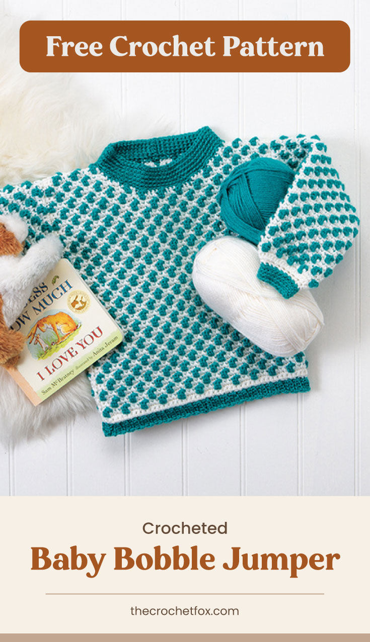 """Text area which says """"Free Crochet Pattern"""" next to a teal and white crochet baby sweater followed by another text area which says """"Crocheted Baby Bobble Jumper"""",thecrochetfox.com"""""""