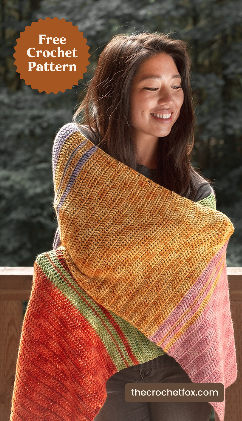 """Text area which says """"Free Crochet Pattern"""" next to woman  wrapping herself in a rectangular crochet shawl  with vibrant colors followed by another text area which says """"thecrochetfox.com"""""""