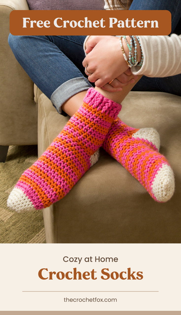 """Text area which says """"Free Crochet Pattern"""" next to a close-up to feet wearing a pair of colorful striped crochet socks followed by another text area which says """"Cozy at Home Crochet Socks, thecrochetfox.com"""""""