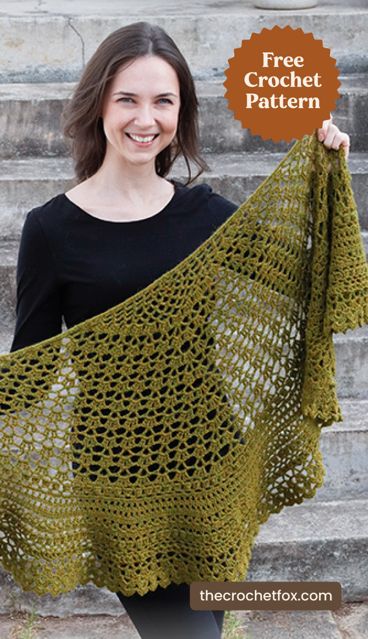 "Text area which says ""Free Crochet Pattern"" next to woman holding a green lace crochet shawl as a scarf followed by another text area which says Delightful Irish Crochet Shawl , thecrochetfox.com"""
