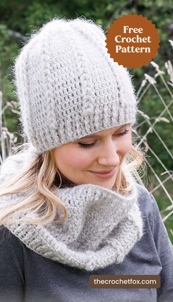 """A woman wearing a light gray crochet cowl with a matching hat and text area which says """"Free Crochet Pattern, thecrochetfox.com"""""""