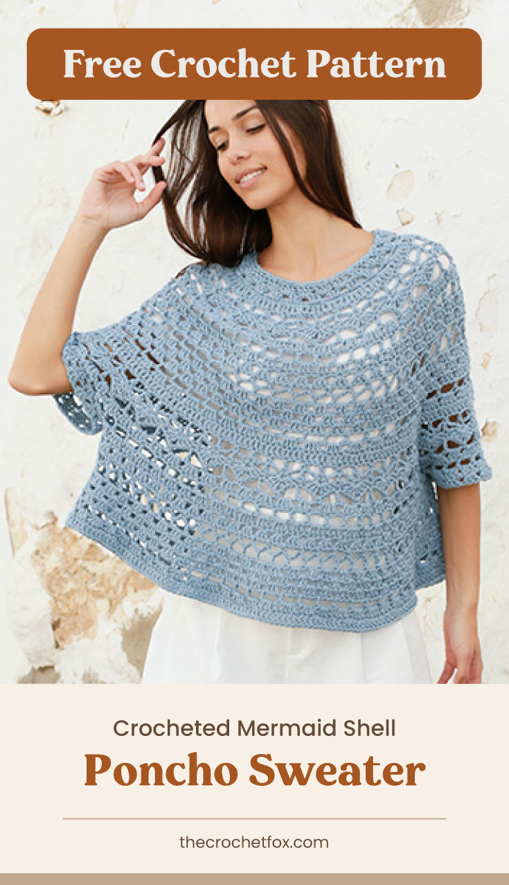 """A woman wearing a light-blue crocheted poncho sweater and text area which says """"Free Crochet Pattern: Crocheted Mermaid Shell Poncho Sweater, thecrochetfox.com"""""""