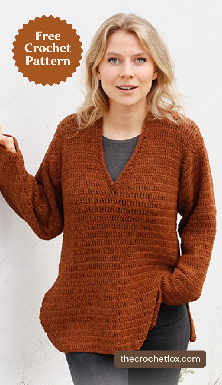 "A woman wearing a burnt orange v-neck crochet sweater and text area which says ""Free Crochet Pattern, thecrochetfox.com"""