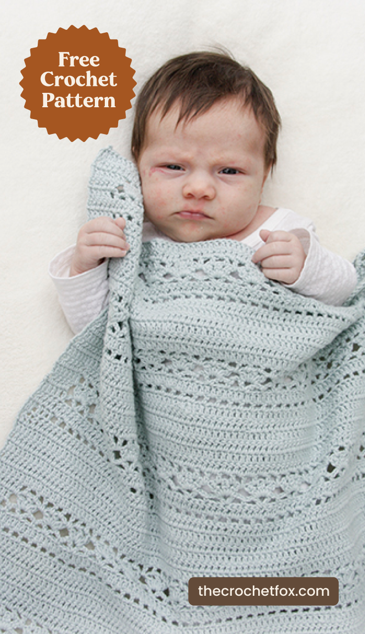 """A baby wrapped in a blue lace crochet baby blanket and text area which says """"Free Crochet Pattern, thecrochetfox.com"""""""