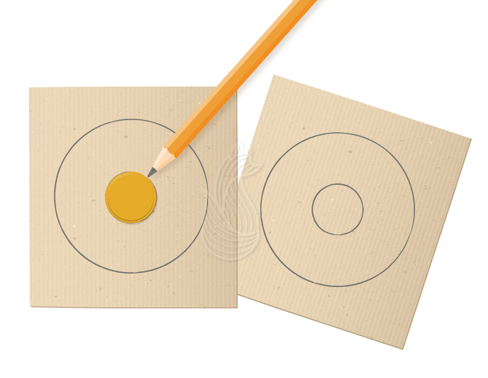 How to Make Pom Poms Step 2: A yellow bottle cap being traced on a piece or cardboard using a pencil.