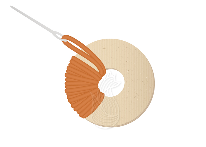 How to Make Pom Poms Step 5: Orange yarn threaded in a tapestry needle being wrapped around a circular cardboard many times.