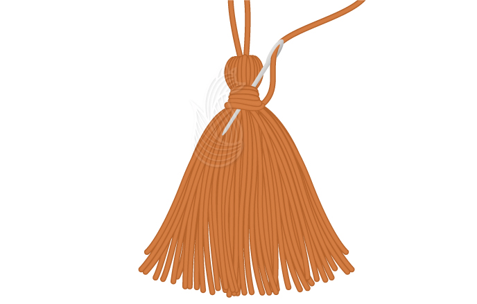 How to Make A Tassel Step 7: A orange tassel with a tapestry needle being inserted in it